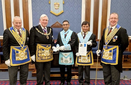 <center>The ProProvGM accepting a cheque for The 2020 Festival from <br>the WM Bro U. Ragwhani with the PM H Bavaria flanked by <br>the ProvGChStwd and the ProvGDC</center>