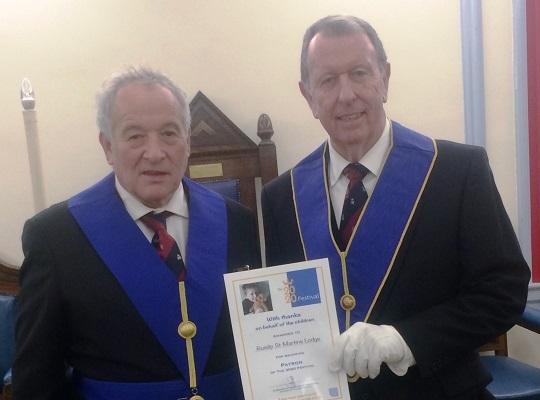 Ruislip St Martins Lodge, No. 9125 -<br>Charity Steward W Bro Peter Binstead<br> receiving Patron Certificate